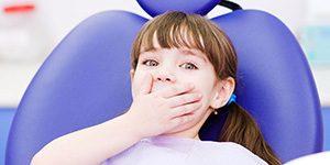 Удаление молочного зуба ребёнку